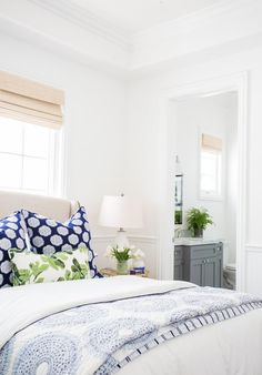 Bedroom decor ideas - blue and white color palette with green accents, simple beautiful transitional style bedroom | StudioMcGee via desiretoinspire.net
