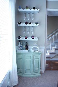 A home bar is one of the most fun places in the house, and it's a great area to add a pop of color—whether in the cabinetry, stools, walls or art. Check out 33 custom home bar design ideas. All styles, sizes and materials. Mini Bars, Bar Design, House Design, Design Ideas, Wine Shelves, Wine Storage, Glass Shelves, Café Bar, Bar Cart