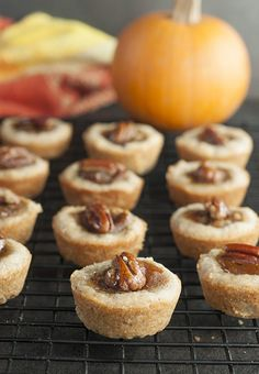 Mini Pecan Pumpkin Pies holiday dessert recipe is all that is wonderful about the holidays rolled into one bite size treat! No need to choose between pumpkin pie or pecan pie at your next party!