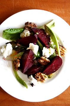 This roasted beet salad features salted roasted beets. They taste delicious. And sweet. And perfectly firm. And add a new and interesting flavor to a traditional goat cheese, beet, and walnut salad. The orange dressing spooned over all of it is also particularly nice! // @alexandracooks