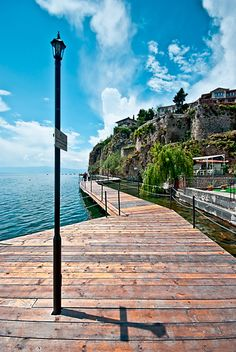This actually reminds me of a walking path Joel and I used to use most days in Airlie Beach.  Loved going for a walk and watching the dugongs play or sea turtles swim by....    Lake Ohrid, Macedonia