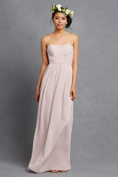 Subtle ruching highlights this flowy sweetheart chiffon gown with a floor length soft a-line skirt.
