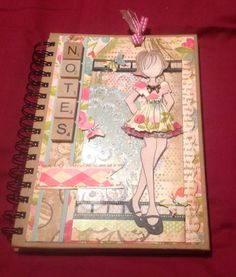 Altered note book with prima doll stamp.