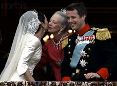 Royal Wedding of Danish Prince Frederik and the former Mary Donaldson (now Crown Princess Mary of Denmark), being kissed by Queen Margethe II of Denmark.