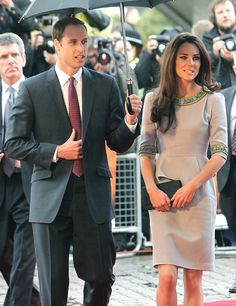 """Prince William and wife Kate Middleton haven't made any public appearances together since January, but when the two decided to step out on Wednesday in London for the premiere of the film """"African Cats,"""" they got caught in the rain. (It is London, after all!) Luckily, Duchess Catherine has a very chivalrous husband willing to hold an umbrella for her!"""