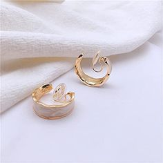 Amazon.com: Miyabi Grace Women's Elegant White Enamel Gold Invisible Spiral Clip On Hoop Earrings Comfortable Non Pierced Earrings Pierced Look: Jewelry Pierced Earrings, Clip On Earrings, Hoop Earrings, Have Metal, Brass Material, Cushion Pads, White Enamel, Spiral, Amazon