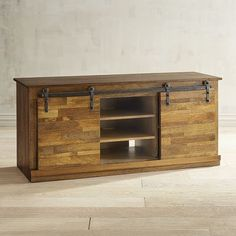 Rustic sliding doors give our Warren TV Stand all kinds of industrial farmhouse charm. You'll appreciate how the mango wood's java finish mimics the look of reclaimed wood. Plus, multiple shelves provide plenty of storage while still allowing easy access. Your TV never had it so good!