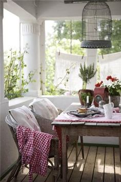 """farm table, bird cage, red gingham, wicker, clothesline """"curtains"""", red geraniums, comfy pillows...these are a few of my favorite things. :-)"""