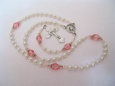 Tiny baby girl rosary.