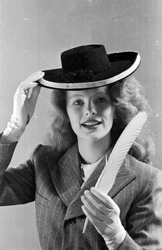 9th October 1943: Film actress Peggy Cummins modelling a home made hat which can…