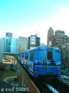 Proud To Be Home In The D: The People Mover and City Skyline, Detroit, Michigan. 8x10 Matted Art Photograph.