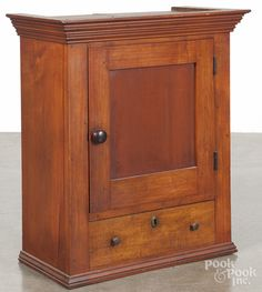 "Pennsylvania stained maple and pine hanging cupboard, 19th c., 27"" H. x 20-3/4"" W."