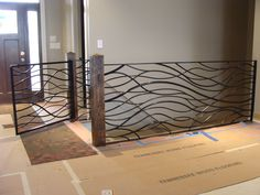 Organic metal stair railing and gate for custom home by Jezroc Metal Works