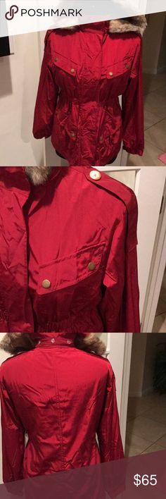 Ali Rio beautiful red coat w/ detachable fur hood Cranberry red medium weight ladies coat•detachable fur hood, •elastic waist detail•four front pockets•zipper and snap front closure•Velcro wrist closure for warmth• Really nice coat Needs a pressing Ali Ro Jackets & Coats