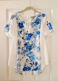 Great Summer Top! I usually am not a fan of white, but there's enough blue that I love it.
