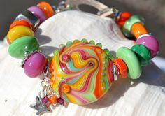 TUTTI FRUITI- Handmade Lampwork and Sterling Silver Bracelet by livilubaby on Etsy https://www.etsy.com/listing/101537057/tutti-fruiti-handmade-lampwork-and
