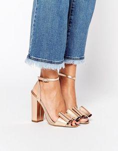 Keep your peep-toe's fresh with a metallic bow. $82.00