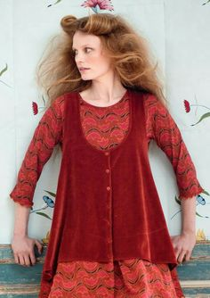 I would knit this (by machine?) in four pieces, then sew/embellish Alabama Chanin style.