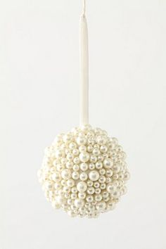 Good idea for ornaments!  Simple and elegant - glue pearls to Styrofoam. This would look even better w/ a mix of gems. Could also be done w/ flowers. Or a mix.