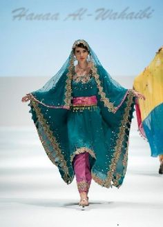 This is a traditional spin on Omani womens clothing. I like the colorful yet modest flow of fabric. It has sassy written all over it.which some may disapprove of but that's another story. For now this is all mine. Ethnic Fashion, Hijab Fashion, Brown Girl, Girl Guides, Childrens Hospital, Designer Gowns, Traditional Dresses, Mille, Hijabs