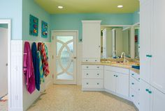 KIDS BATH: Wall color is Forget Me Not by Benjamin Moore and the ceiling color is Hibiscus by Benjamin Moore. Floor tile to resemble beach.