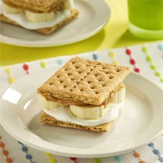 A twist on the classic s'more recipe is made with creamy peanut butter, marshmallow creme and sliced banana sandwiched between graham crackers