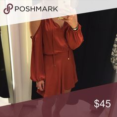 Orange / red cold shoulder boho dress Orange / red cold shoulder boho dress. Super flattering and very in style! Zips shut at the back, has dangle drawstring if you want to tie a bow in the front. Comes in at the waist. No flaws Zara Dresses Mini