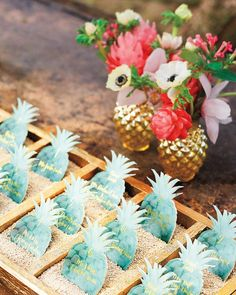 """""""We love pineapples!"""" says Lian; the pair celebrated the fruit on escort cards and vases."""