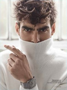 Model Jon Kortajarena wears a cream cashmere turtleneck sweater by Private White V.C.