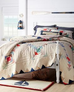Create a nautical bedroom with our contemporary take on a traditional quilt, paired with a whimsical sailboat rug and decor to remind you of the beach.