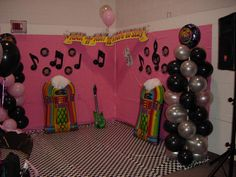 Decoration ideas for an outdoor movie party showing Grease on an inflatable movie screen - Southern Outdoor Cinema expert tip for theming and enhancing an outdoor movie event.