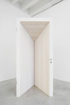 Gunilla Klingberg | The Doors, 2010 wonderful simple sculptural art installation playing with light and form to create thirs repeat pattern and kinetic texture