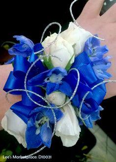 corsages | blue delphinium, white mini roses, white lisianthus, silver ting ting, blue satin ribbon