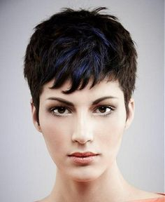A short black straight coloured multi-tonal blue spikey haircut womens hairstyle by Mob Salons