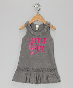 Sometimes sibling sweetness just has to be flaunted, and this darling dress displays it well. Trimmed with layered lettuce edges, this soft, stretchy piece is ready for playtime and pictures.60% cotton / 40% polyesterMachine wash; tumble dryImported