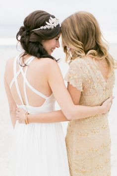 Adorable moment between bride and maid of honor   Read more: http://www.stylemepretty.com/florida-weddings/2014/09/18/intimate-diy-florida-wedding-at-st-pete-beach/   Photography: J. Layne Photography - http://jlaynephotography.com/