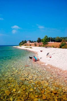 Things to do in Wisconsin's Door County include Whitefish Dunes State Park, Peninsula Players Theatre, fish boils, cherry picking and lighthouse cruises.