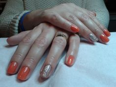 A dry manicure complete with CND Shellac 'Desert Poppy' nail polish & 'Silver Holographic' glitter on the ring  fingers.