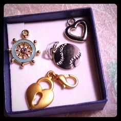 4 charms ~ one great Price ~  Cute ~ Nautical charm ~ would be pretty on a chain ~  Center has a clear Rhinestone ~ delicate little piece of jewelry both sides are the same which makes it nice if your necklace twists ~ 2 little heart charm which would also look cute on a necklace~ the baseball charm is new ~ all four for one price!   Jewelry Necklaces