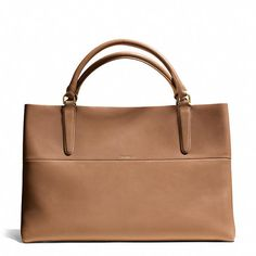 Coach creates an effortlessly chic tote in smooth leather with a neatly bonded suede interior.
