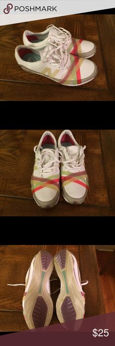 New Balance By Nine West In great condition white sneakers highlighted with pink, yellow, light green and purple. Super comfortable and light weight for every day. Shoes Sneakers