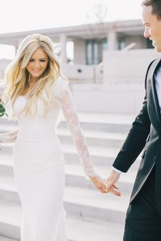 Wedding dress with sleeves! Love the lace sleeves!