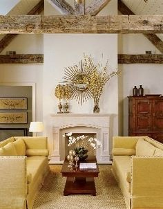 love the mix of rustic and formality in this living room. Love the beautiful yellow sofas - giving the room of pop of color.
