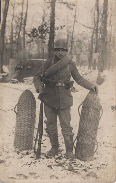 WWI, German soldier with shell carriers.