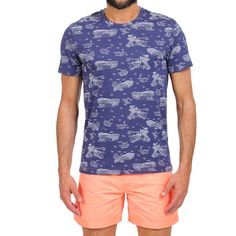 ISLAND PRINT T-SHIRT COLOR BLUE Blue cotton scoop neck T-shirt with all-over island landscape print. Short sleeves. COMPOSITION: 100% COTTON. Model wears size L, he is 189 cm tall and weighs 86 Kg.