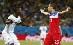 FIFA World Cup 2014, Match 13: Ghana vs USA United States' Fabian Johnson, right, and Ghana's Jonathan Mensah question the referee's call during the group G World Cup soccer match between Ghana and the United States at the Arena das Dunas in Natal, Brazil, Monday, June 16, 2014. (AP Photo/Julio Cortez)