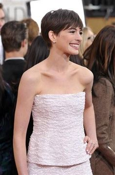 (Photo by John Shearer/Invision/AP). Actress Anne Hathaway hair for Golden Globes 1/13/13