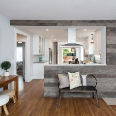 Who says white kitchens have to be dull? Add a splash of flavor with reclaimed wood. 🏡Link To More Farmhouse-Inspired White Kitchen Ideas In Bio🏡 Design: Photo: Half Wall Kitchen, Open Kitchen And Living Room, Kitchen Room Design, Modern Kitchen Design, Kitchen Layout, Kitchen Interior, Home And Living, Kitchen Ideas, Kitchen Pass