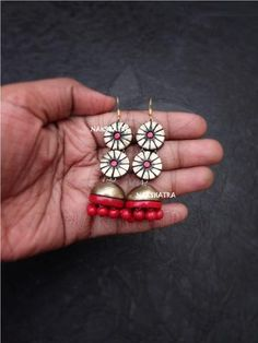 Handmade Terracotta Antique Gold And Red Color Geometric Design Jhumka Earring By Nakshatra Jewelry Design Earrings, Funky Jewelry, Clay Jewelry, Terracotta Jewellery Online, Terracotta Jewellery Designs, Handmade Jewelry Designs, Earrings Handmade, Handmade Jewellery, Butterfly On Flower
