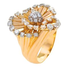 AN CLEEF & ARPELS 'Tourbillion' Gold Diamond Retro Ring – Macklowe A French Retro 18 karat gold and platinum ring with diamonds by Van Cleef & Arpels. The Tourbillion ring features a 48 round-cut diamonds that form a swirl with a pave center with an approximate total weight of 2.90 carats. Circa 1951